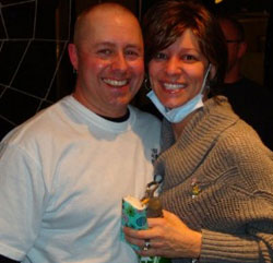 Kathleen & her husband Greg (after she shaved his head at the benefit)